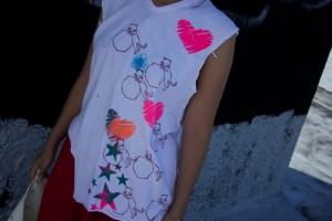 montage tee top for ladies with cats, stars, and multi colored hearts with fun textures