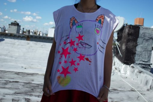 super cute shirt with a badly drawn cat and tons of stars. Pink, blue, yellow and lots of whiskers. One size fits most