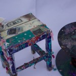 weird furniture. Collage table with fun textures, stars, coins & colors