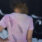 feathers on a pink shirt
